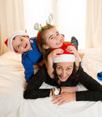 Happy Mum, daughter and little son playing at Christmas — Φωτογραφία Αρχείου