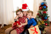 Happy Young Mum, son and daughter at Christmas — Zdjęcie stockowe