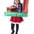 Cute Little Girl in Santa Claus costume happy holding presents at Xmas — Zdjęcie stockowe