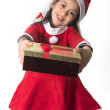 Cute Little Girl in Santa Claus costume holding a Christmas Box — Stock Photo
