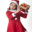 Cute Little Girl in Santa Claus costume holding a Xmas Box — Stock Photo