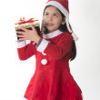 Foto de Stock  : Cute Little Girl in SantClaus costume holding Xmas Box