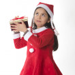 Foto Stock: Cute Little Girl in SantClaus costume holding Xmas Box