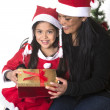 Little girl and Mother kissing and giving Xmas Present — Stock Photo