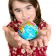 Cute lgirl holding little World Globe on her Hands — Stock Photo