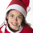 Cute Little Girl in Santa Claus costume happy holding presents at Xmas — Stok fotoğraf