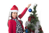 Little Happy Girl in Santa hat hanging Xmas Bubble — Stock Photo