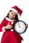 Little girl on Santa Claus costume holding Watch — Stock Photo
