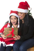 Little girl and Mother kissing and giving Xmas Present — Φωτογραφία Αρχείου