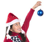 Little Happy Girl in Santa hat hanging Xmas Bubble — Stockfoto