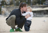 Young Father holding and kissing his little child — Stock Photo