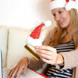 Womonline Christmas shopping with computer and credit card — Stock Photo #37152967