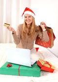 Young beautiful woman online Christmas shopping — Stock Photo