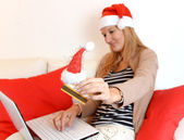Woman online Christmas shopping with computer and credit card — Stock Photo