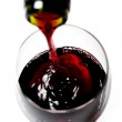 Bottle neck close up filling Glass with Red Wine — Stock fotografie