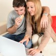 Young couple internet shopping — Stock Photo #37527947