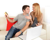 Couple in trouble cause of spending money on i-shopping — Stock Photo