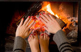 Woman warming her hands ands feet — Stock Photo