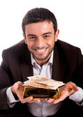 Happy business man with a goldbar and bank notes — Stock Photo