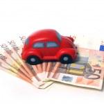 Miniature car and euro banknotes 01 — Stock Photo