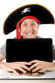Young man in pirate costume and Computer — Stock Photo
