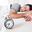 Young attractive man sleeping on bed — Stock Photo #39069297