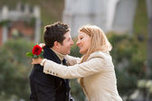 Couple with a rose kissing on valentines day — Stock Photo