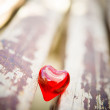 Macro red heart on a vintage wooden chair — Stock Photo