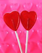 Couple of red heart shape lollipops in love concept — Stock Photo