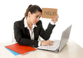 Busy business woman working on her laptop help sign — Stock Photo