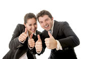 Business man and woman giving thumbs up white background — Stock Photo