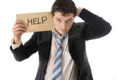 Stressed business man holding help sign — Stock Photo