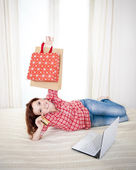 Happy attractive woman online shopping — Stock Photo