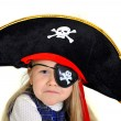 Cute little  blonde girl in pirate hat and eyepatch playing — Stock Photo #41433821