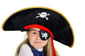 Cute little  blonde girl in pirate hat and eyepatch playing — Stock Photo