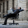 Business Man sitting on Office Chair on Street with Computer — Stock Photo #41885969