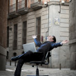 Business Man sitting on Office Chair on Street with Computer — Stock Photo #41886017