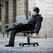 Stock Photo: Tired Business Msitting on Office Chair on Street sleeping