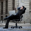 Happy Business Man sitting on Office Chair on Street with Computer — Stock Photo #41886351