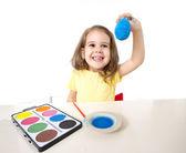 little girl painting dyed egg for Easter celebration  — Stock Photo