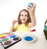 Little girl painting dyed egg for Easter celebration — Stock Photo