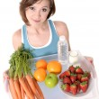 Stock Photo: Young attractive red hair womwith healthy fruit tray and water