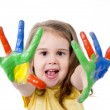 Stock Photo: Happy little girl with hands painted in vivid colours