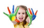 Canlı renklerle boyanmış el ile mutlu küçük kız — Stok fotoğraf