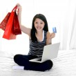 Asian american woman with credit card and shopping bags — Stock Photo #43030207