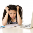 Pretty asian woman student overworked on her laptop on white bac — Stock Photo #43364429