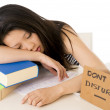 Young pretty chinese asian student asleep on her laptop — Stock Photo #43365309