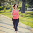 Pretty red haired woman running in the park  — Foto de Stock   #43370043