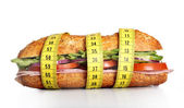 Vegetal Sandwich wrapped in measure tape in diet concept — Stock Photo