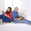 Постер, плакат: Antisocial latin couple while on laptop and tablet